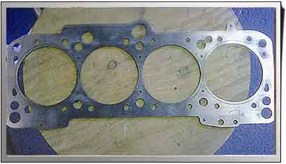water jet cut cylinder head spacer
